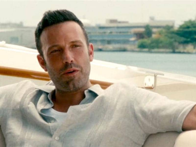 Ben Affleck lounges gallantly in a still from Runner Runner.