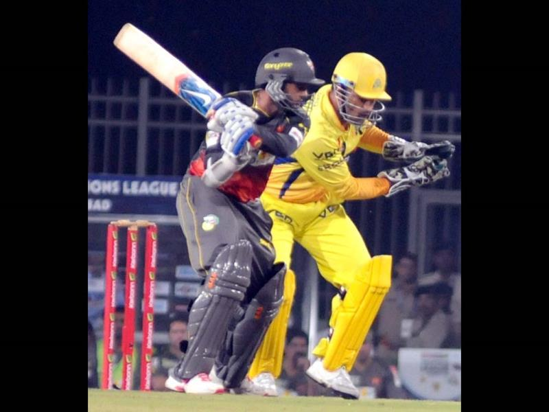 Sunrisers Hyderabad Parthiv Patel plays a shot as Mahendra Singh Dhoni looks on during the CLT20 match against Chennai Super Kings in Ranchi on Thursday. (PTI Photo)