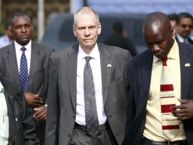 US ambassador to Kenya Robert Godec (C) arrives for the funeral prayers of victims of the the Westgate shopping mall attack. (Reuters Photo)