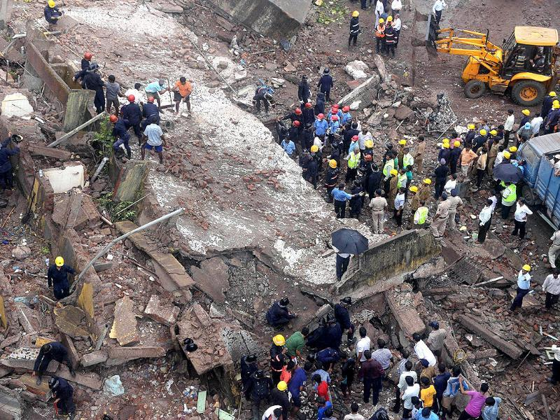 Yet another building has collapsed in Mumbai. Here, firefighters and rescue workers are seen working at the site of the building collapse. (AFP Photo)
