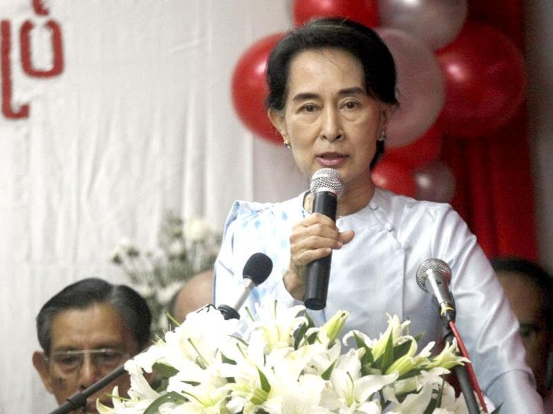 Myanmar Opposition Leader Aung San Suu Kyi delivers a speech during a ceremony at her party headquarters in Yangon, Myanmar. (AP Photo)