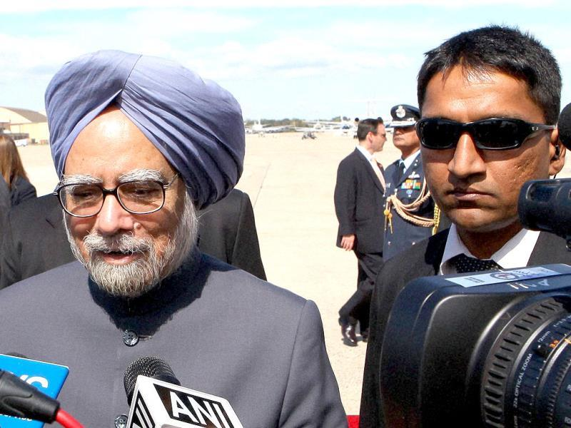 Prime Minister Manmohan Singh talks with media on his arrival at Andrews Air Force Base, Maryland airport in Washington, USA. (PTI Photo)