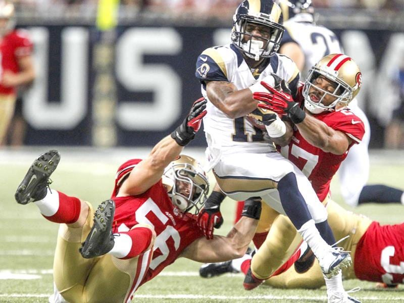 St Louis Rams wide receiver Tavon Austin (C) tackled by San Francisco 49ers linebacker Nathan Stupar (L) and defensive back CJ Spillman during the second half of their NFL football game in St. Louis, Missouri. (Reuters Photo)