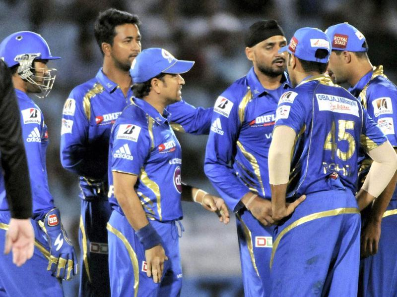 Mumbai Indians players celebrate the wicket of a Highveld Lions batsman during their Champions League Twenty 20 cricket match in Jaipur. (PTI Photo)