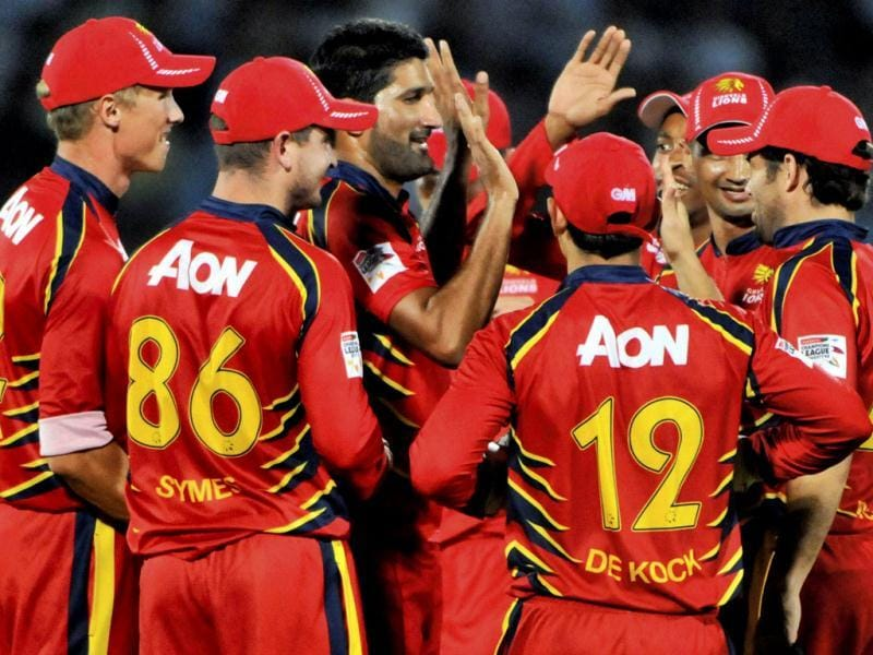 Highveld Lions bowler Sohail Tanveer (c) with teammates celebrate the wicket of Mumbai Indians batsman Sachin Tendulkar during their Champions League Twenty 20 cricket match in Jaipur. (PTI Photo)