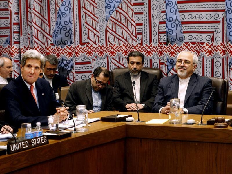 Seated at the table from left, US secretary of state John Kerry, Iranian foreign minister Mohammad Javad Zarif and European Union foreign policy chief Catherine Ashton attend a meeting. (AP Photo)