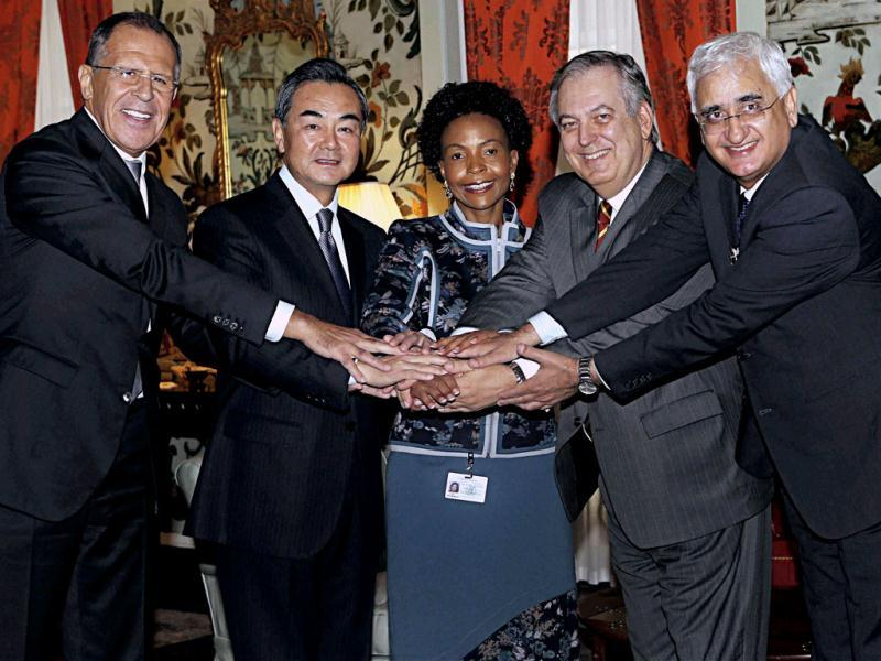 External affairs minister Salman Khurshid and his counterparts shake hands during a luncheon under the framework of the 68th session of the United Nations General Assembly, at the UN headquarters in New York. (PTI Photo)