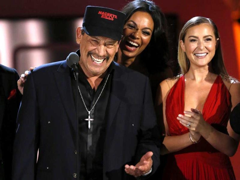 Actors Danny Trejo (L), Rosario Dawson and Alexa Vega (R) smile on stage at the 2013 NCLR ALMA Awards at the Pasadena Civic Auditorium in California. (Reuters Photo)