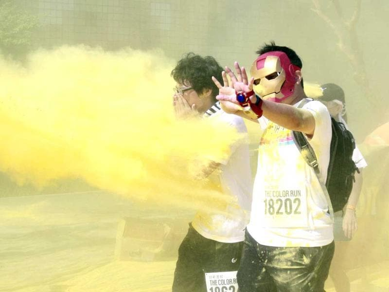 A runner gets pelted with color powders during the Color Run at the Dajia Riverside Park in Taipei, Taiwan. (AP Photo)