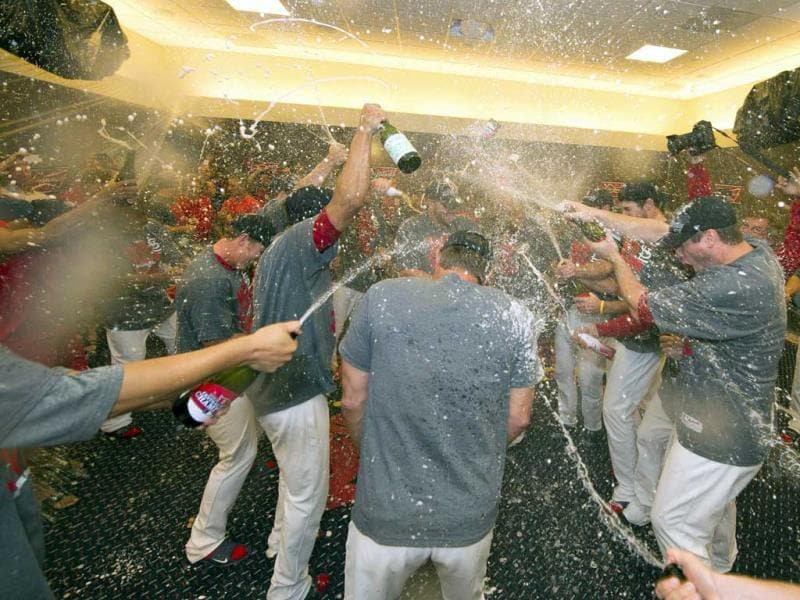 The St Louis Cardinals celebrate after their game against the Chicago Cubs at Busch Stadium. The Cardinals defeated the Cubs 7-0 to win the National League Central Title. (Scott Rovak/AP Photo)