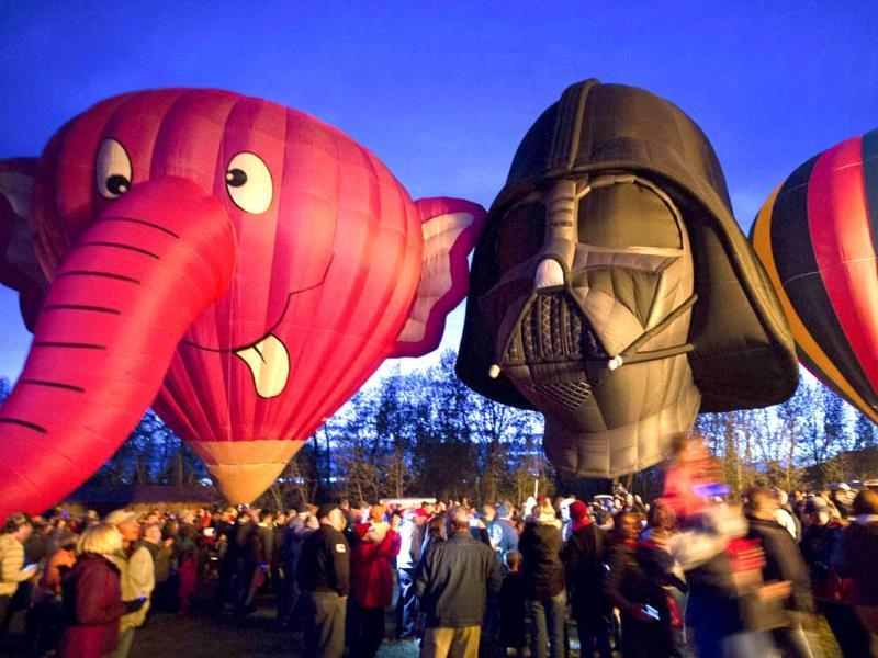 Hot air balloons, shaped like characters Nelly-B and Darth Vader, displayed during a night glow on the evening of Day 3 of the Canadian Hot Air Balloon Championships. (Reuters Photo)