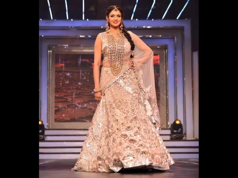 Sridevi donned a white semi ghagra sari with silver work all over and sported heavy jewellery.