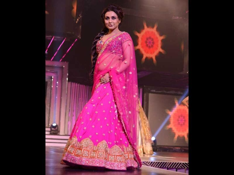 Rani Mukherji donned pink ghagra-choli with golden nathni (nose ring) minus other jewellery.