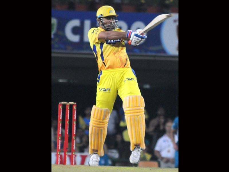 Chennai Super Kings captain MS Dhoni plays a shot during the CLT20 match against Brisbane Heat's in Ranchi. (PTI Photo)
