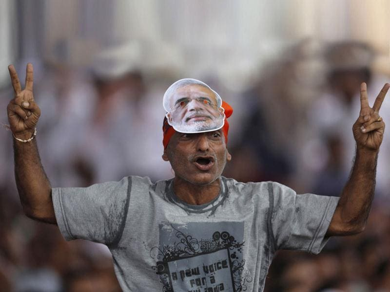 A supporter of BJP wears a mask of Narendra Modi, Gujarat CM and BJPs PM candidate. (Reuters Photo)