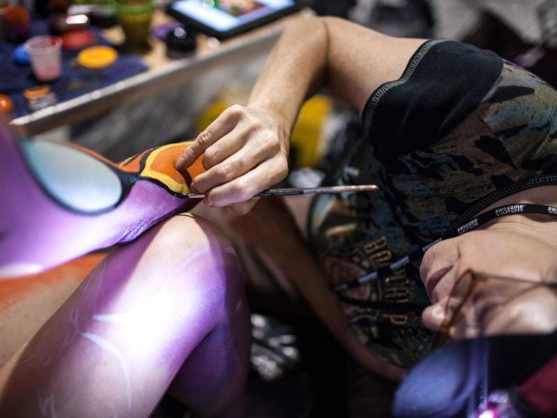 An artist paints on a model during the competition, the first such contest sanctioned by the World Bodypainting Association. (AP Photo)