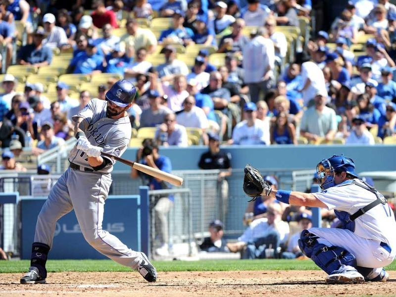 Todd Helton #17 of the Colorado Rockies pops out in the fourth inning against the Los Angeles Dodgers at Dodger Stadium in Los Angeles. (AFP Photos)