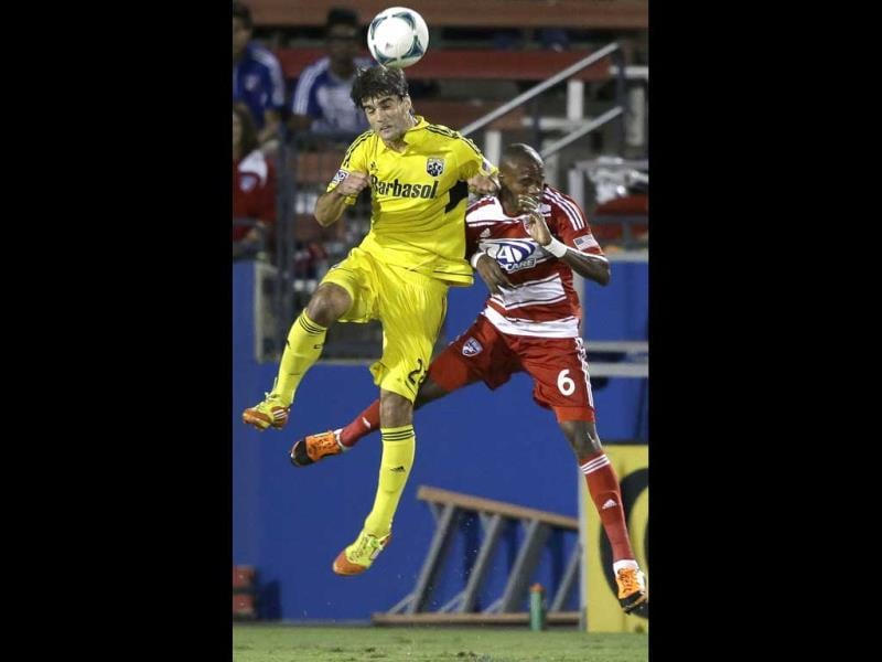 Columbus Crew's Agustin Viana (24) and FC Dallas' Jackson Goncalves (6) jump for a head ball during the first half of an MLS Soccer game in Firsco, Texas. (AP Photo)