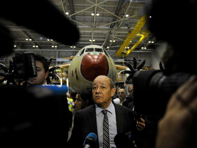 French defence minister Jean-Yves Le Drian visits the A400M assembly line during the A400M First Delivery Ceremony in Sevilla. (AFP Photo)