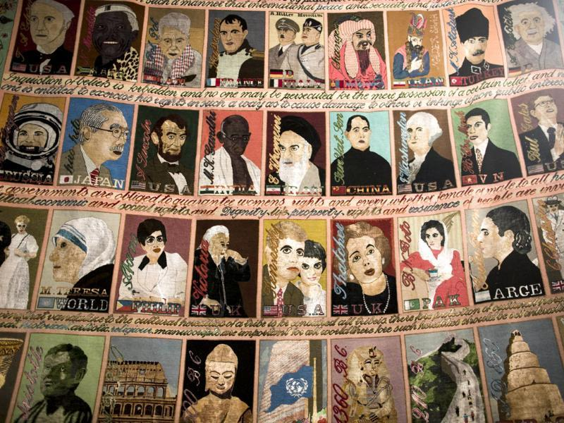 An Iranian hand-woven carpet, depicting portraits of the famous world leaders and charachters, archeaologic sites and statues is on display at Iran's International hand-woven carpet exhibition in Tehran. (AFP Photo)