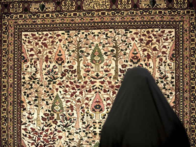 An Iranian woman visits Iran's international hand-woven carpet exhibition in Tehran. (AFP Photo)