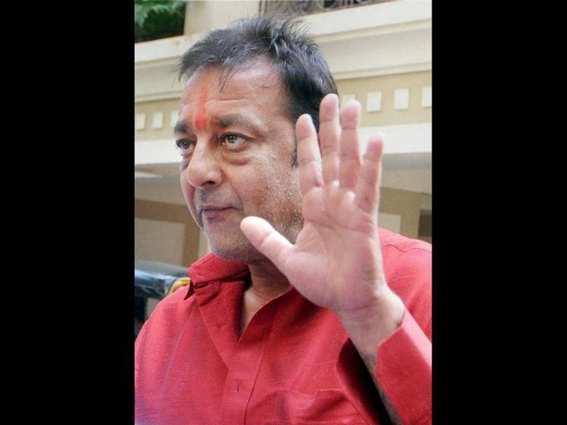 Bollywood actor Sanjay Dutt arrives at his residence in Mumbai on Tuesday after he was granted a two-week parole by Pune's Yerawada Central Jail authorities for medical reasons. (PTI)