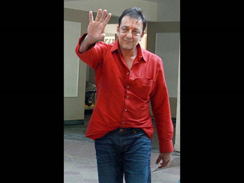 Sanjay Dutt waves at his fans after he reached home.
