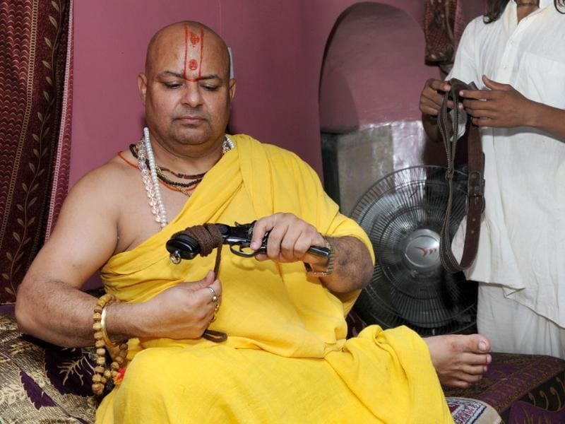 In UP, even sadhus wield guns. Mahanth Janmejay Sharan, president of Ramjanambhoomi Mandir Nirman Nyas in Ayodhya, has a licenced pistol and a double barrel gun. He says he fears a rival. (Ashok Dutta/HT Photo)
