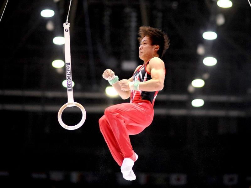 Japan's Ryohei Kato competes in the still rings qualifications during the competition in Antwerp, Belgium. (AFP Photo)