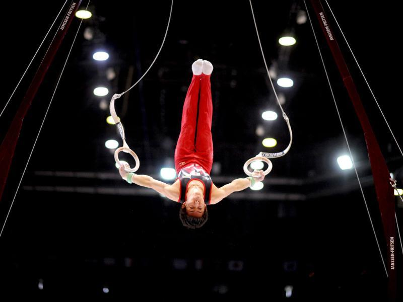 A gymnast competes in the still rings qualifications during the Artistic Gymnastics World Championships. (AFP Photo)