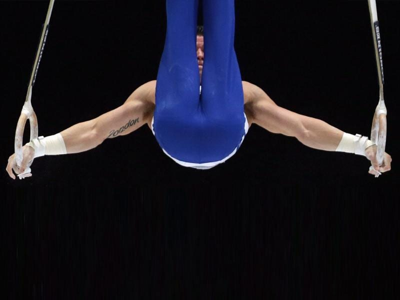 US gymnast Alexander Naddour competes on the rings during a qualification session at the Artistic Gymnastics World Championships. (AP Photo)