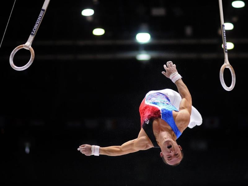 France's Danny Pinheiro Rodrigues competes in the still rings qualifications in Antwerp, Belgium. (AFP Photo)