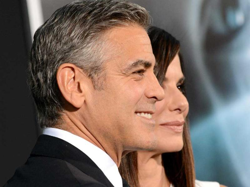 Actors George Clooney and Sandra Bullock attend the premiere of 'Gravity' at the AMC Lincoln Square Theaters in New York. (AP Photo)