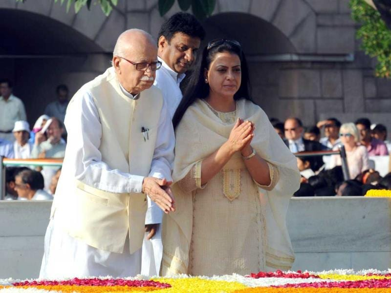 Senior leader of main opposition Bharatiya Janata Party (BJP) Lal Krishna Advani (L) is accompanied by his daughter Pratibha as he pays his respects at the memorial to the Mahatma Gandhi at Rajghat in New Delhi on his 144th birth anniversary. (AFP Photo)