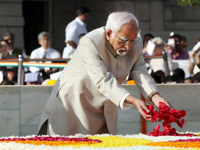 Vice-president Hamid Ansari pays homage to Father of the Nation Mahatma Gandhi on the occasion of his 144th birth anniversary at his memorial at Rajghat in New Delhi. (PTI Photo)