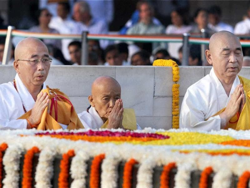 Buddhist monks pay homage to Father of the Nation Mahatma Gandhi on the occasion of his 144th birth anniversary at his memorial at Rajghat in New Delhi. (PTI Photo)