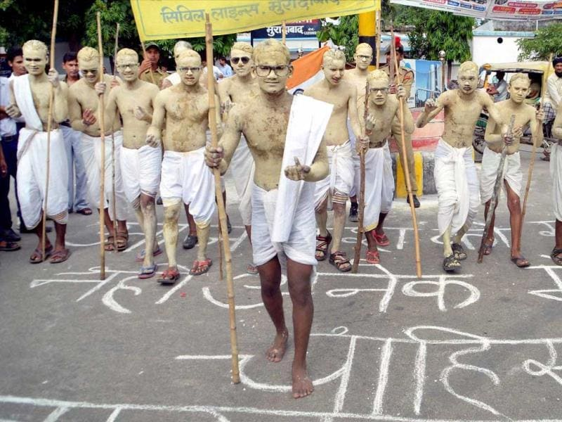 School students dressed as Mahatma Gandhi take out a march on the occasion of his 144th birth anniversary in Moradabad. (PTI Photo)