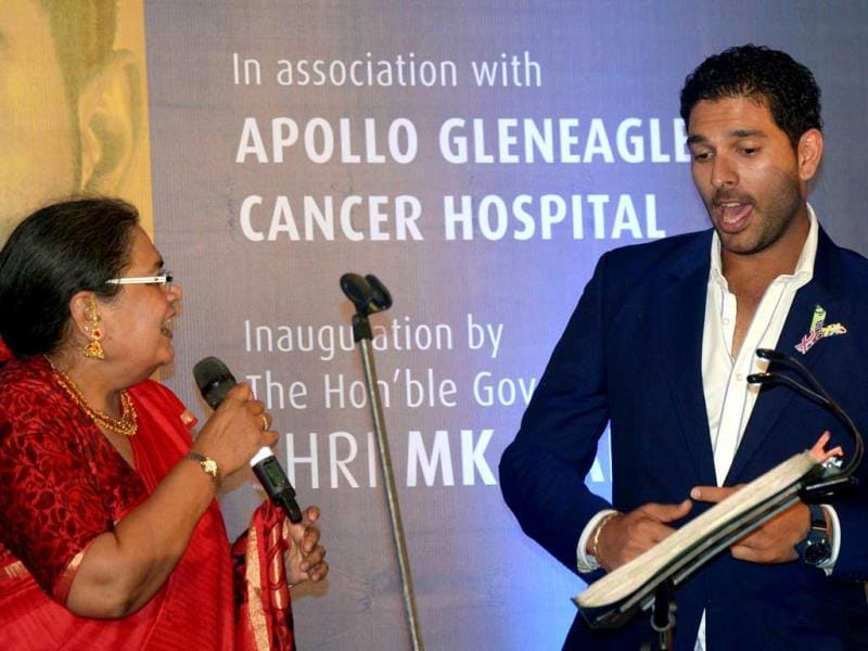 Yuvraj Singh dances with Bollywood playback singer Usha Uthup during a function in Kolkata on October 1, 2013. The function was organised by various NGO's to promote cancer awareness. (AFP Photo)