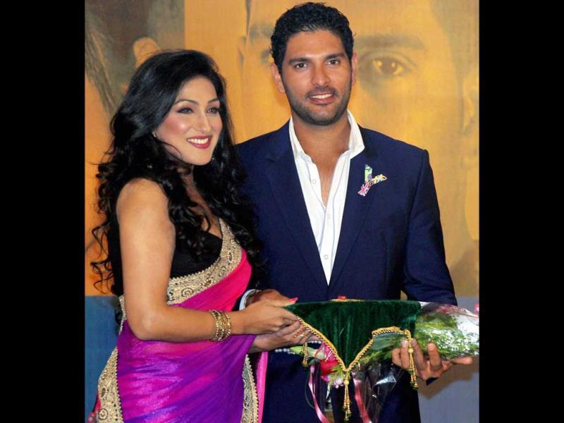 Cancer survivors cricketer Yuvraj Singh and actress Rituparna Sengupta during in Kolkata on Tuesday. (PTI Photo)