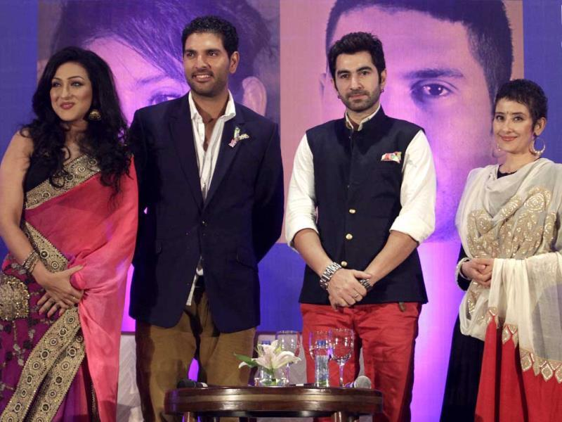 Cancer survivors Manisha Koirala and Yuvraj Singh attend an interactive session Cancer has an answer, along with actress Rituparna Sengupta and actor Jeet in Kolkata on Oct. 1, 2013. (AP Photo)