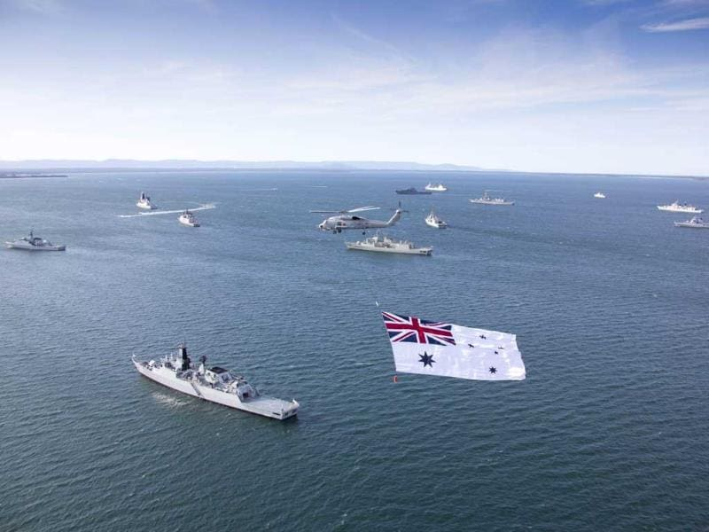 Royal Australian Navy and international warships ready to sail into Sydney, for the International Fleet Review to commemorate the navy's very first fleet entry 100 years ago. (AFP Photo)