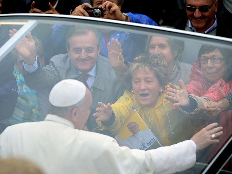 Pope Francis meets followers in Assisi during his first visit here to honour the saint whose name he adopted. (AFP Photo)