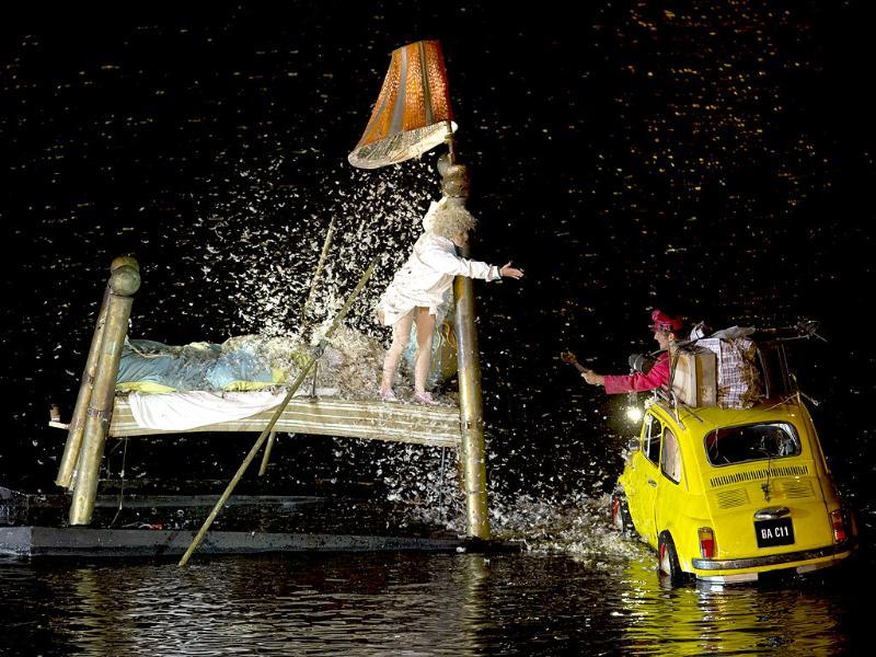 Artists perform on the water canals around the Puerto Madero neighborhood at the opening of 9th Buenos Aires' International Festival. (AP Photo)
