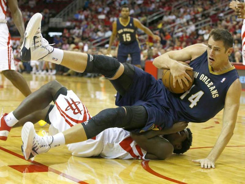 Jason Smith #14 of the New Orleans Pelicans falls on Terrence Jones #6 of the Houston Rockets in a preseason NBA game at Toyota Center in Houston, Texas. (AFP/Getty Images)