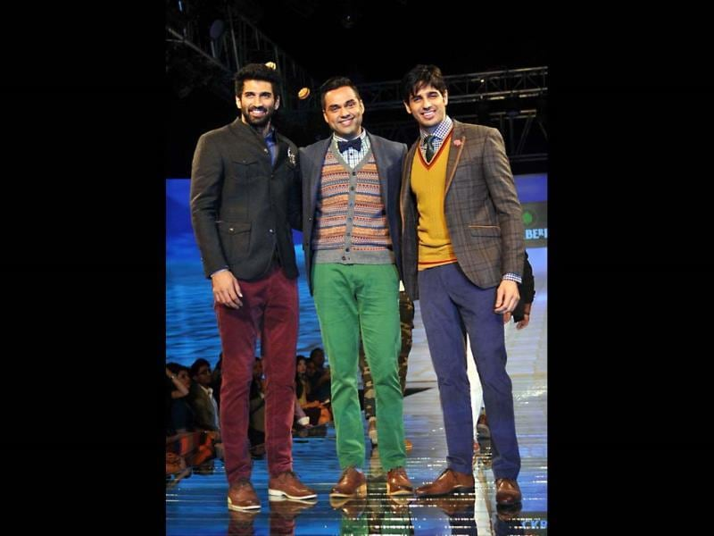 Aditya Roy Kapur, Abhay Deol and Sidharth Malhotra walk the ramp for Showstoppers Blackberry's Sharp Nights Progressive fashion show. (AFP Photo)
