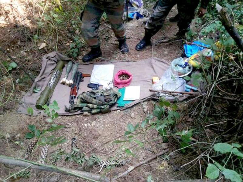 Arms and ammunition recovered from a militant hideout busted by Army in Keran sector. Photo by ANI