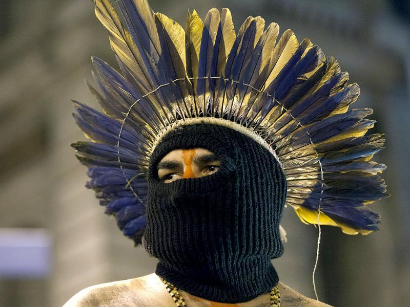 An indigenous man wears a mask during a march in support of teachers on strike in Rio de Janeiro, Brazil. (AP Photo)