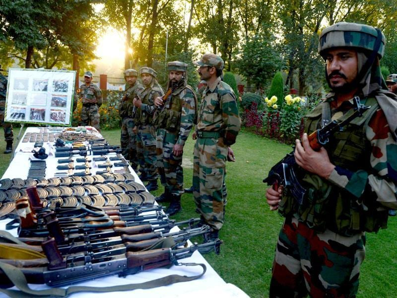 Indian troops display arms and ammunition captured from suspected militants after a gun battle in the Keran sector at the Line of control in Srinagar. (AFP Photo)