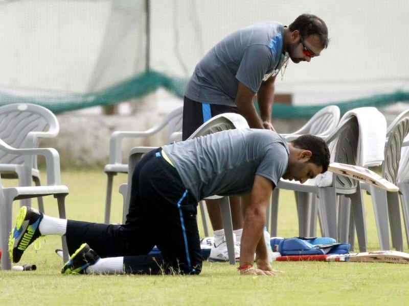 Yuvraj Singh and Amit Mishra during the practice session at Khanderi stadium in Rajkot. (HT Photo/Virendra Singh Gosain)