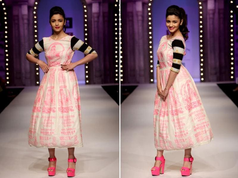 The Wills Lifestyle India Fashion Week opened today in the capital. And the gorgeous and peppy Alia Bhatt walked the ramp for designer Masaba. Bright pink rules the collection, check it out!